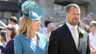 بيتر فيليبس حفيد الملكة إليزابيث وزوجته أوتام في حفل زواج الأمير هاري وميغان يوم 19 مايو 2018