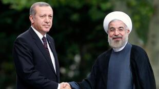 الرئيس الإيراني حسن روحاني والرئيس التركي رجب طيب أردوغان