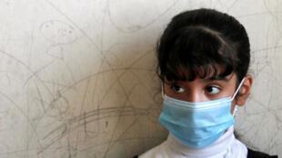 تلميذة عراقية في مدرسة ببغداد