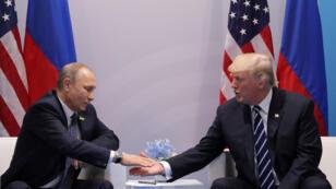 لقاء بوتين وترامب خلال قمة العشرين في هامبورغ، ألمانيا 07-07-2017