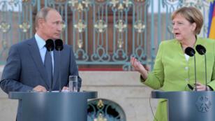 المستشارة الألمانية انغيلا ميركل والرئيس الروسي فلاديمير