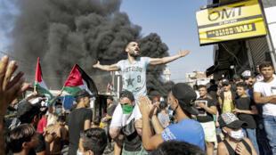 فلسطينيون يتظاهرون ضد حملة رسمية لمكافحة العمالة الأجنبية في لبنان