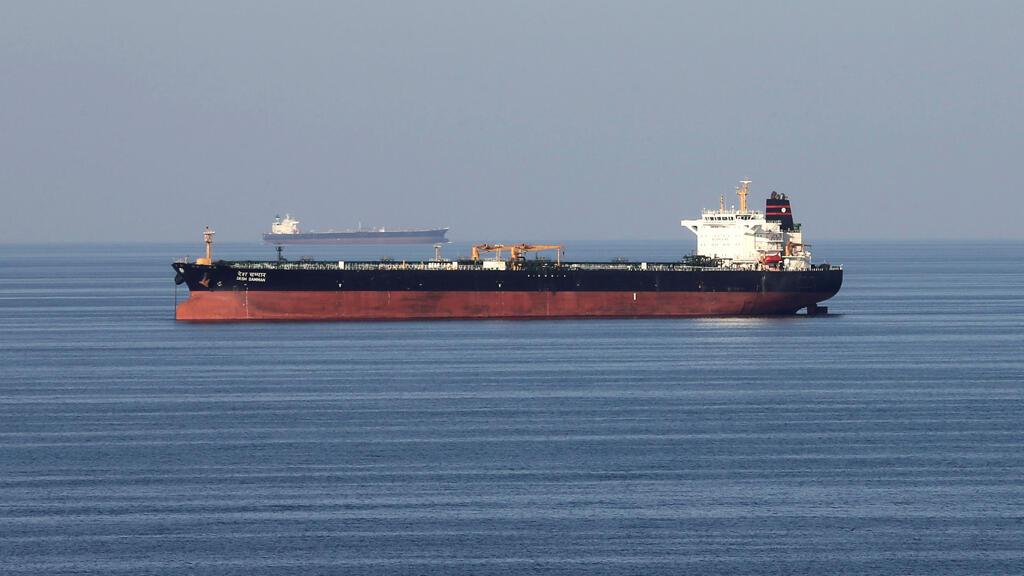 Oil tankers pass through the Strait of Hormuz