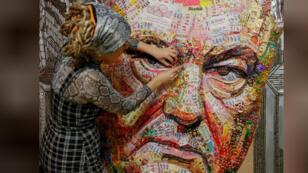 الفنانة داريا مارتشينكو تصنع لوحة لرئيس أوكرانيا من الحلوى وفوارغ الرصاص في كييف