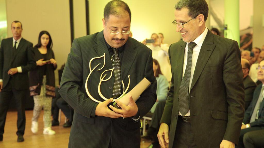 محمد التفراوتي مع رئيس الحكومة المغربية سعد الدين العثماني خلال حفل  تسليم جوائز الحسن الثاني للبيئة في يوليو 2018