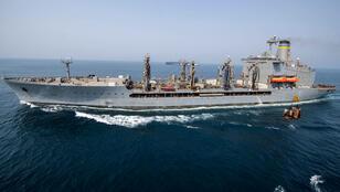 Fleet replenishment oiler USNS Big Horn sends stores to the amphibious transport dock ship USS John P. Murtha during a replenishment-at-sea, Arabian Sea off Oman