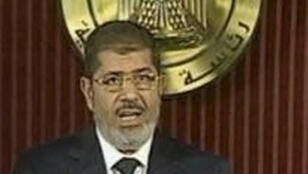 وقائع جلسة النطق بالجكم على الرئيس المصري المعزول محمد مرسي 21 أبريل- نيسان 2015