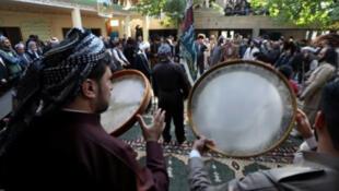 مسلمون صوفيون في كردستان العراق يحتفلون بعيد المولد النبوي في 19 تشرين الثاني/نوفمبر