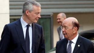 وزير الاقتصاد الفرنسي برونو لومار ونظيره الأمريكي ويلبور روس