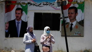 2021-05-25T121104Z_1712580443_RC2PLN9QN38H_RTRMADP_3_SYRIA-SECURITY-ELECTION-HOMS