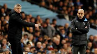 بيب غوارديولا (على اليمين) وأولي جونار سولسكاير مدرب مانشستر يونايتد خلال مبارة يوم 29 يناير 2020 على استاد الاتحاد