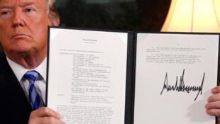 توقيع ترامب على الانسحاب من الاتفاق النووي الايراني