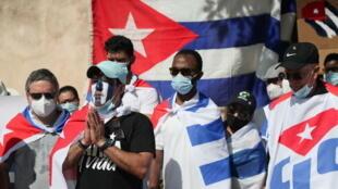 2021-07-18T220738Z_1087593159_RC2XMO98O5YW_RTRMADP_3_CUBA-UNREST-DOMINICANREPUBLIC