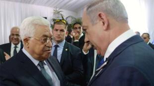 لقاء بين محمود عباس وبنيامين نتانياهو خلال تشييع جنازة شيمون بيريز يوم 30 سبتمبر 2016