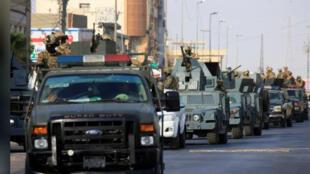 قوات الرد السريع بشارع في البصرة بجنوب العراق