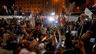 راشد الغنوشي يتحدث إلى أنصاره بعد أن حصل الحزب على معظم الأصوات في الانتخابات البرلمانية التي أجريت يوم الأحد-