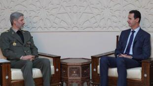 الرئيس السوري بشار الأسد ووزير الدفاع الإيراني أمير حاتمي