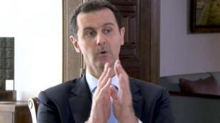 الرئيس السوري بشار الاسد يتحدث خلال مقابلة تلفزيونية في دمشق
