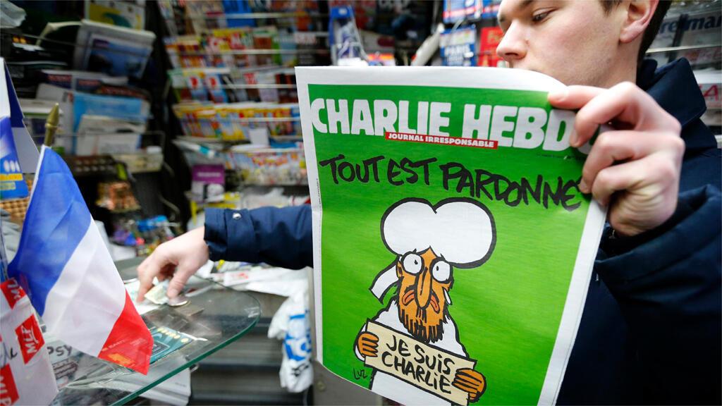 """عدد """"شارلي ايبدو"""" الأول بعد الاعتداء الإرهابي الذي تعرضت له يحمل رسماً للنبي محمد كتب فوقه """"كل شيء مغفور"""""""
