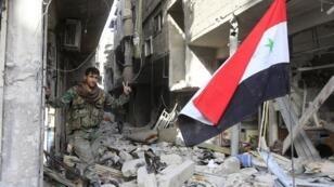 أحد عناصر الجيش السوري
