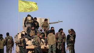 مسلحون من قوات سوريا الديمقراطية
