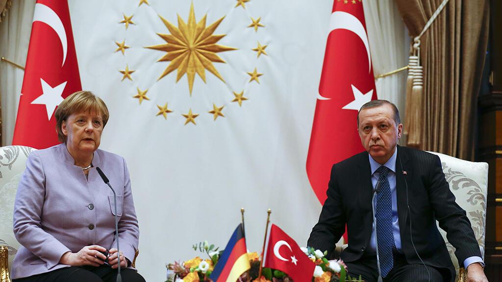 الرئيس التركي رجب طيب اردوغان والمستشارة الألمانية انغيلا ميركل