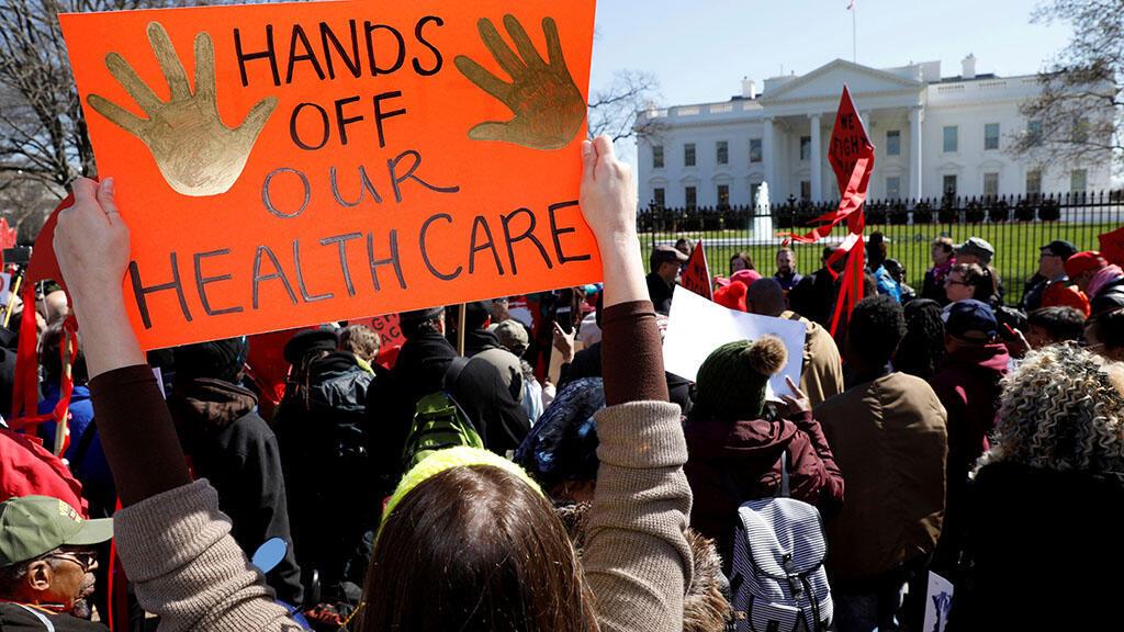 متظاهرون أمريكيون ضد مشروع لإلغاء قانون أوباما كي