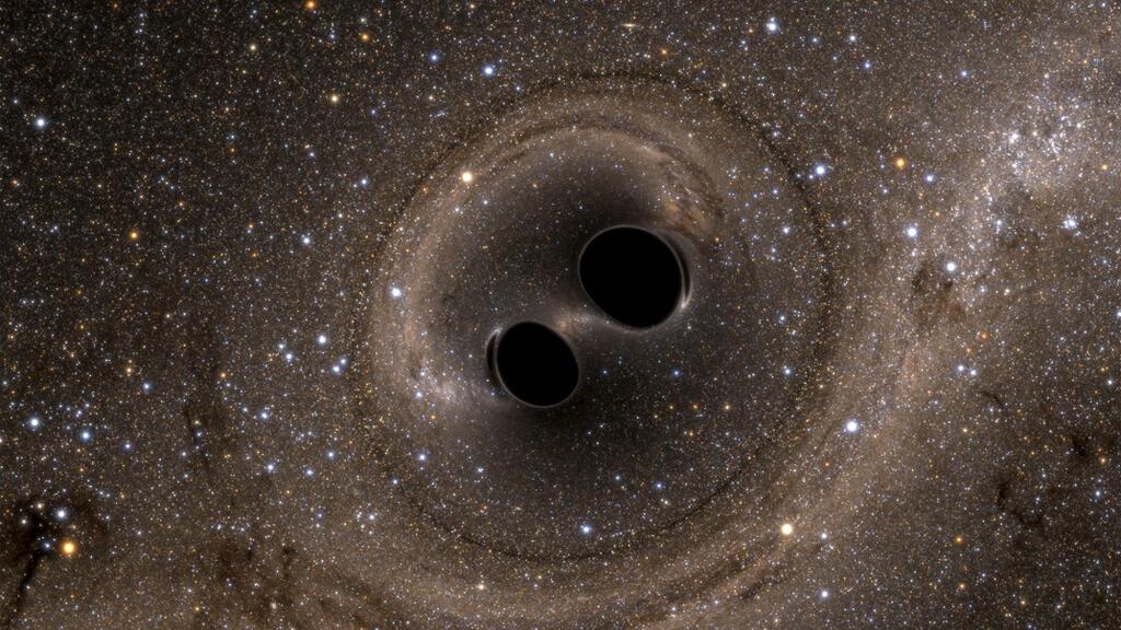 صورة تمثيلية لاصدام ثقبين أسودين في الفضاء