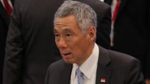 / رئيس وزراء سنغافورة لي هسين لونج الذي استهدف بشكل خاص بالقرصنة المعلوماتية