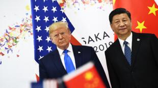 الرئيس الصيني شي جينينغ والأمريكي دونالد ترامب، قمة مجموعة العشرين، أوساكا