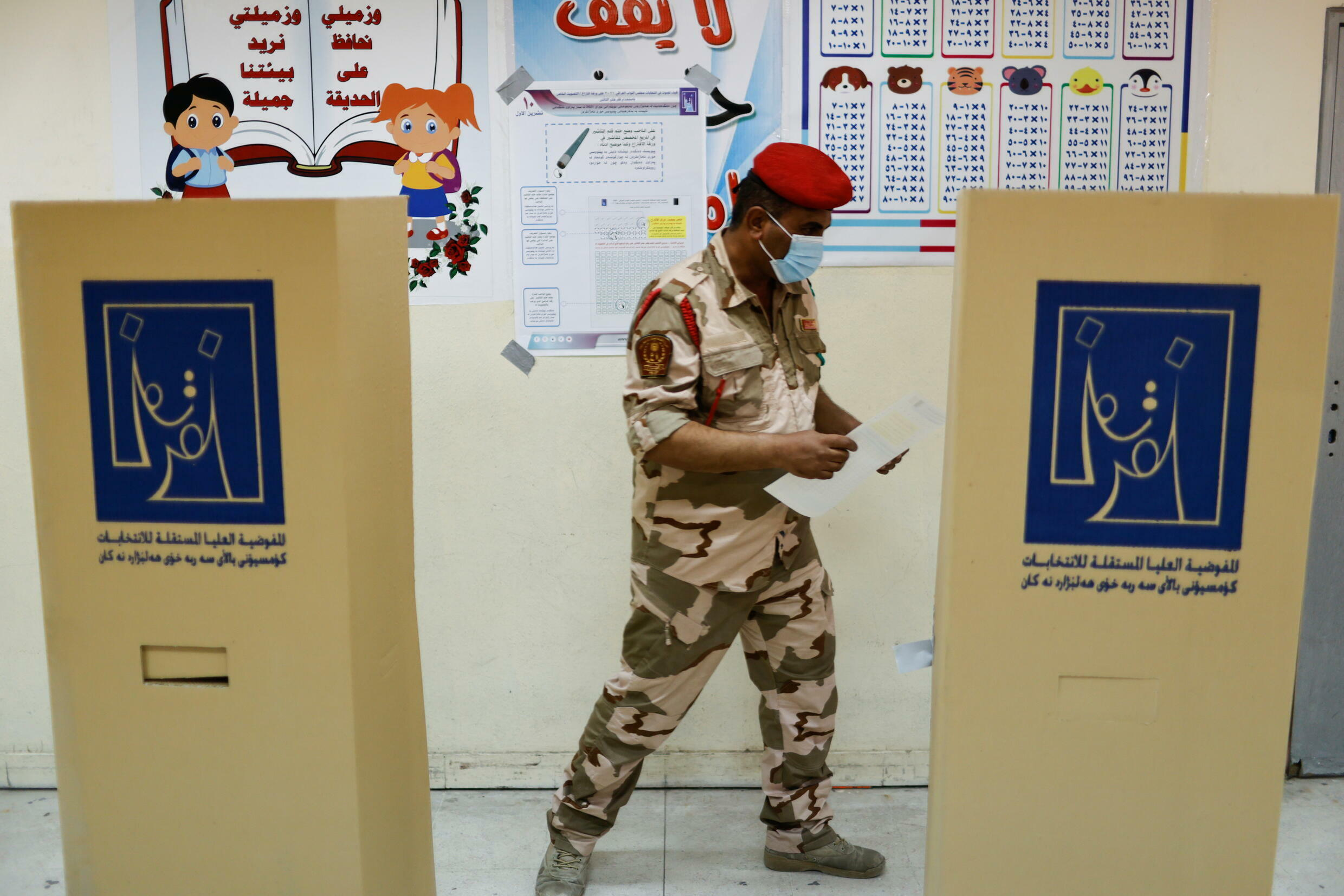 2021-10-08T072422Z_1077219043_RC2J5Q9VSWY9_RTRMADP_3_IRAQ-ELECTION-SPECIAL-VOTING