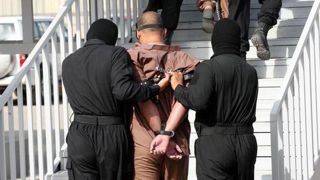 معتقل في طريقه إلى الإعدام  (صورة تعبيرية)
