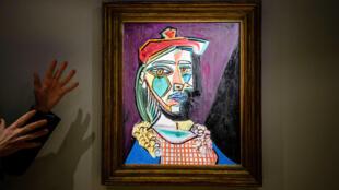 لوحة بابلو بيكاسو التي بيعت في مزاد كريستيز ( أ ف ب)