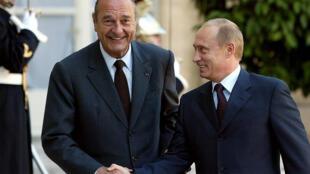 الرئيس بوتين والرئيس الراحل شيراك