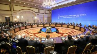 من اجتماعات الجولات السابقة بين وفدي الحكومة السورية والمعارضة