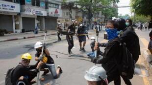 2021-03-14T090703Z_561966714_RC2XAM9Y5FR5_RTRMADP_3_MYANMAR-PROTESTS