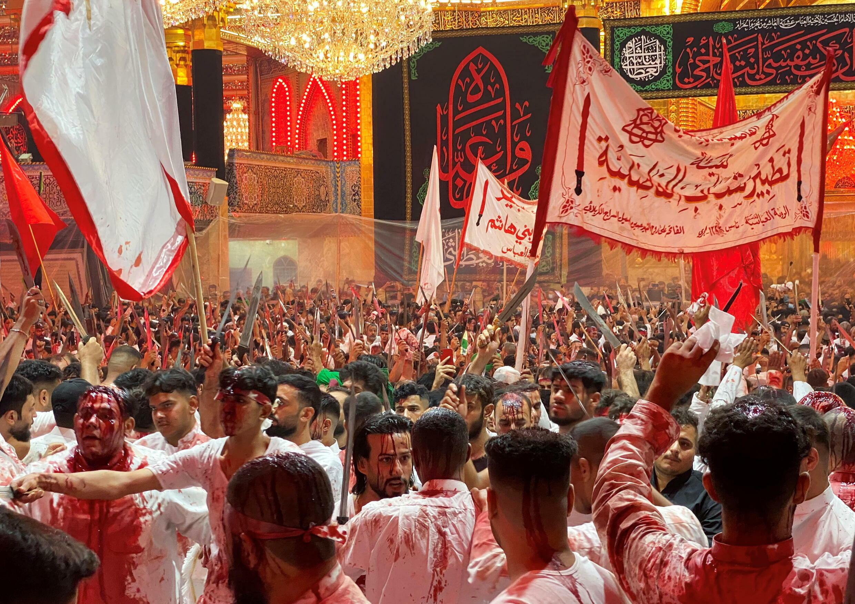 2021-08-19T062901Z_1109437991_RC228P99DK5T_RTRMADP_3_RELIGION-ASHURA-IRAQ