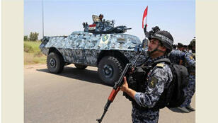 رجل أمن عراقي-
