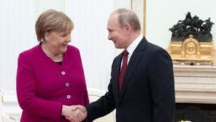 بوتين و ميركل