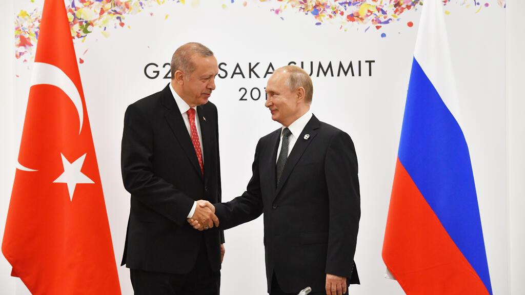 الرئيس الروسي فلاديمير بوتين مع نظيره التركي رجب الطيب اردوغان