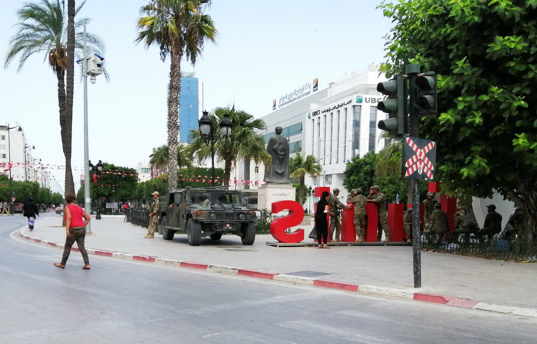 2021-07-28T122820Z_639636932_RC23TO98KV3F_RTRMADP_3_TUNISIA-POLITICS-REACTION
