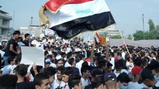 طلاب عراقيون يتظاهرون في بغداد يوم 28 أكتوبر 2019
