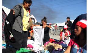 المهاجرون من قافلة تضم الآلاف من أمريكا الوسطى يحاولون الوصول إلى الولايات المتحدة  في ملجأ   بتيخوانا