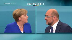 المستشارة الألمانية انغيلا ميركل خلال المناظرة التلفزيونية مع مارتن شولتز