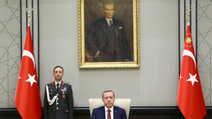 أردوغان خلال اجتماع لمجلس الأمن القومي في أنقرة في حزيران 2015