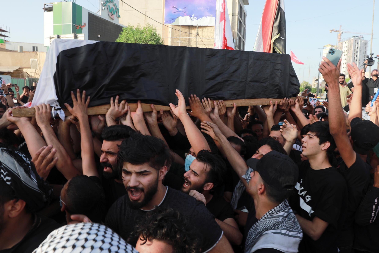 2021-05-09T152735Z_445640729_RC2FCN90ZEG4_RTRMADP_3_IRAQ-PROTESTS-FUNERAL-KERBALA