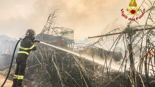 2021-07-25T132206Z_390390602_RC2PRO9CBG7L_RTRMADP_3_EUROPE-WEATHER-ITALY-FIRES
