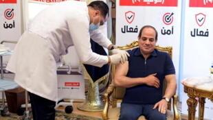 2021-04-25T134503Z_1399334588_RC213N9PZRZD_RTRMADP_3_HEALTH-CORONAVIRUS-EGYPT-SISI