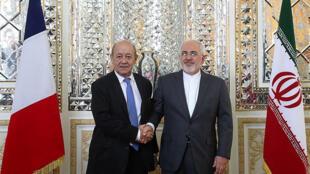 وزير الخارجية الفرنسي جان إيف لودريان ونظيره الإيراني محمد جواد ظريف في إيران