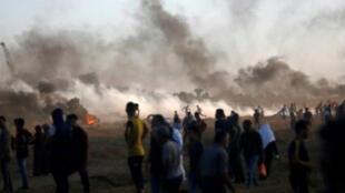 """فلسطيني الجمعة برصاص الجيش الإسرائيلي خلال تظاهرة في إطار """"مسيرات العودة"""" في المنطقة الحدودية."""